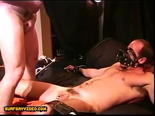 Restrained by ropes as I stomp his balls while I jack off on his pain.